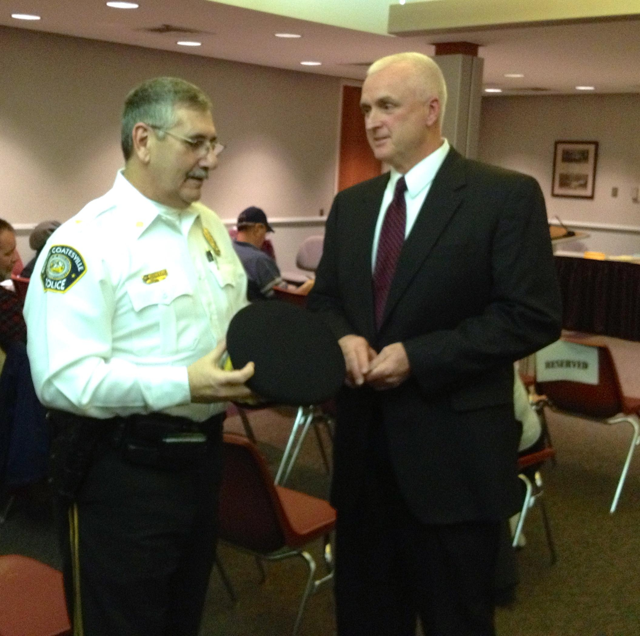 Chief Wilson congratulating Chief Lauffer (Coatesville PD)
